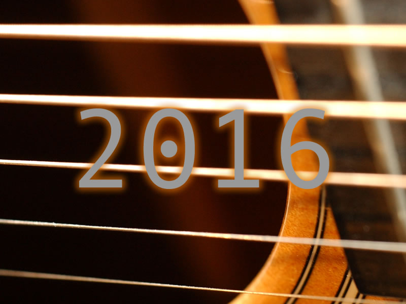 2016 text overlaying picture of acoustic guitar soundhole and strings